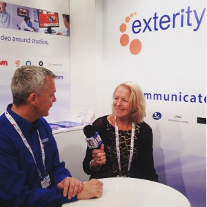 Chief Executive Officer Colin Farquhar of Exterity talking to Janet at his stand
