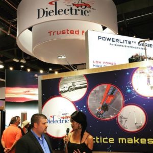 Jaimi talking with the Vice President of Dielectric in their 75th year