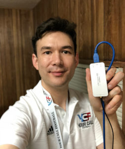 Phenix Senior Engineer Aaron Barlow with a Magewell USB Capture SDI device during the live streaming production of interactive sports experience Your Call Football.